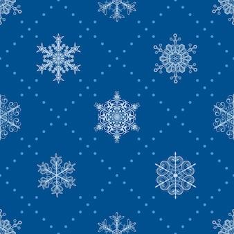 Kerst naadloos patroon van sneeuwvlokken en stippen, lichtblauw op blauw
