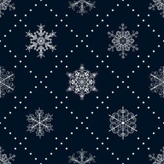 Kerst naadloos patroon van sneeuwvlokken en stippen, wit op donkerblauw