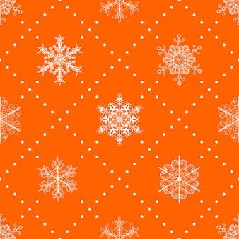 Kerst naadloos patroon van sneeuwvlokken en stippen, wit op oranje