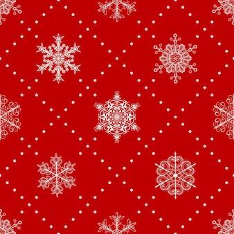 Kerst naadloos patroon van sneeuwvlokken en stippen, wit op rood