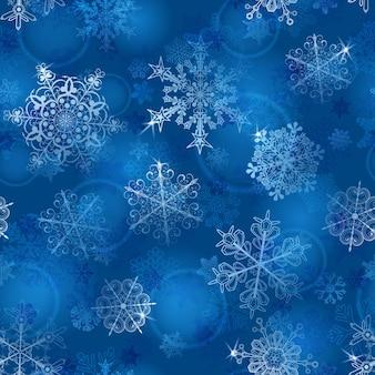 Kerst naadloos patroon van sneeuwvlokken in blauwe kleuren