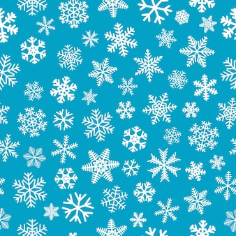 Kerst naadloos patroon van sneeuwvlokken, wit op lichtblauwe achtergrond