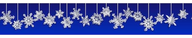 Kerst naadloze banner met volume papier sneeuwvlokken met zachte schaduwen op blauwe achtergrond. met horizontale herhaling