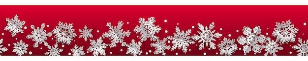 Kerst naadloze banner met volume papier sneeuwvlokken met zachte schaduwen op rode achtergrond. met horizontale herhaling