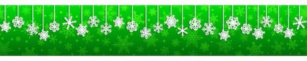 Kerst naadloze banner met witte hangende sneeuwvlokken met schaduwen op groene achtergrond