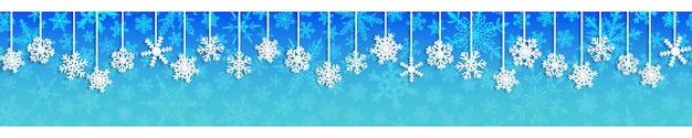 Kerst naadloze banner met witte hangende sneeuwvlokken met schaduwen op lichtblauwe achtergrond