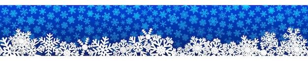 Kerst naadloze banner met witte sneeuwvlokken met schaduwen op blauwe achtergrond