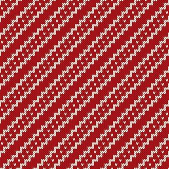 Kerst naadloze brei achtergrond. rood gebreid patroon
