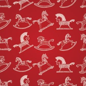 Kerst naadloze handgetekende patroon met speelgoed paarden schommelen
