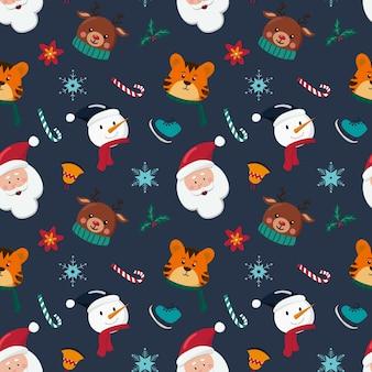 Kerst naadloze patroon met sneeuwpop, santa claus tijger en herten op blauwe achtergrond. hand getekende vectorillustratie