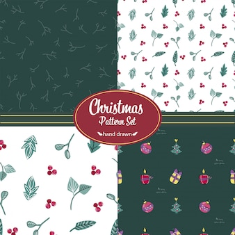 Kerst patronen instellen. hand getrokken doodles. bloemmotieven en kerstversiering