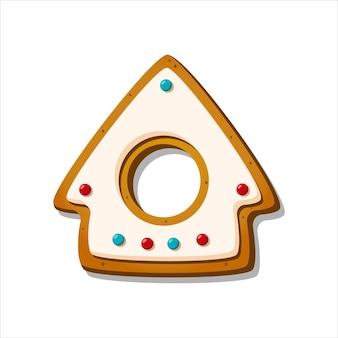 Kerst peperkoek koekje winter geglazuurd koekje in de vorm van peperkoek huis geïsoleerd