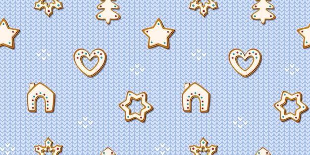 Kerst peperkoek naadloze patroon op blauwe breien achtergrond. feestelijke koekjes in de vorm van sneeuwvlokken en bomen, sterren en huizen, sneeuwvlokken en harten. vector gebakken geglazuurde koekjes ontwerp.