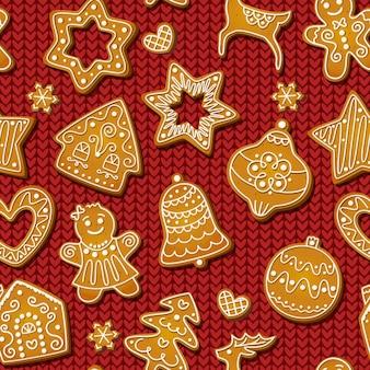 Kerst peperkoek naadloze patroon op rode breien achtergrond. feestelijke koekjes in de vorm van mannen, sneeuwvlokken en bomen, sterren en huizen, sneeuwvlokken en rendieren. vector gebakken koekjesontwerp.