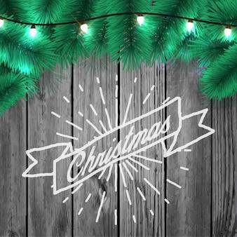 Kerst pijnboomtak een houten achtergrond