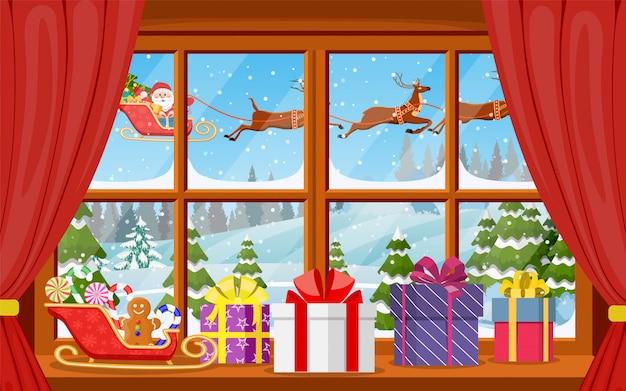 Kerst raam uitzicht met een besneeuwd landschap