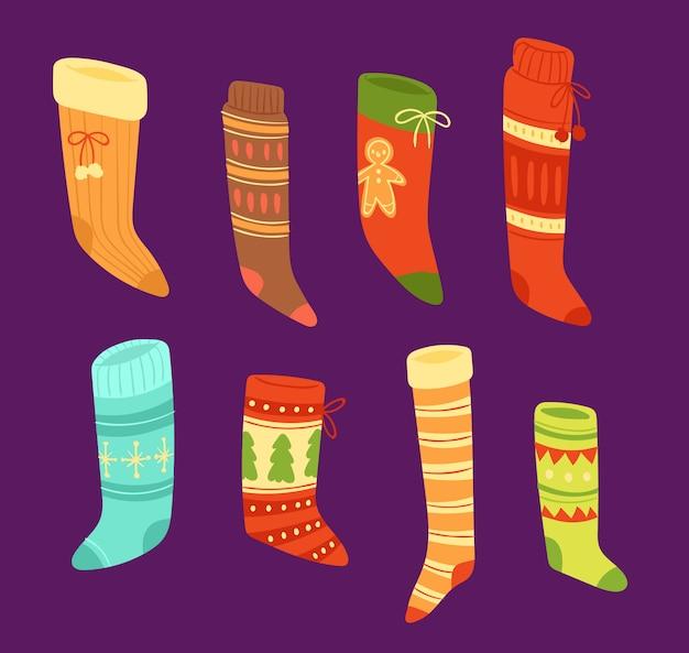 Kerst sokken santa xmas nieuwjaar cadeau traditionele christenen symbool sey illustratie verschillende textiel voedsel kleding Premium Vector