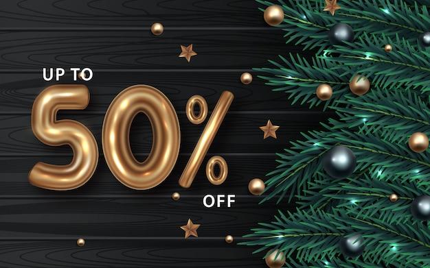 Kerst verkoop banner. realistische sparrentakken met bessen en ballen