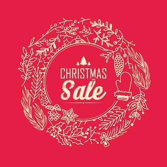 Kerst verkoop krans sjabloon met tekst over kortingen in het midden van decoratief frame op rood
