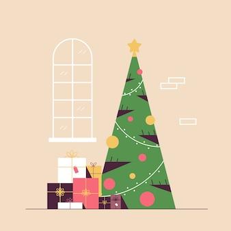 Kerst versierde groene dennenboom met cadeau huidige dozen vrolijk kerstfeest gelukkig nieuwjaar vakantie viering concept vectorillustratie
