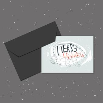 Kerst wenskaart met envelop gemaakt in vector. kerst handgemaakte elementen met belettering voor perfecte kaarten en uitnodigingen. trendy nieuwjaarsontwerp.