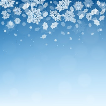 Kerst winter blauwe achtergrond met vallende sneeuwvlokkensneeuwval