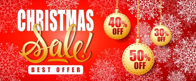 Kerstaanbieding aanbod belettering en kerstballen