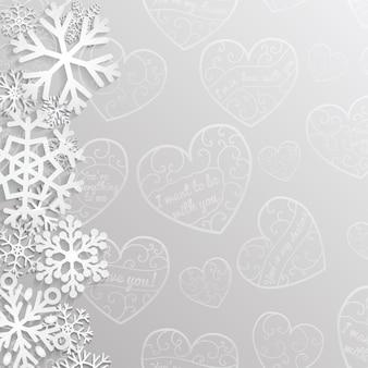 Kerstachtergrond met hartjes en sneeuwvlokken in grijze kleuren