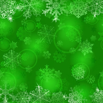 Kerstachtergrond met sneeuwvlokken in groene kleuren