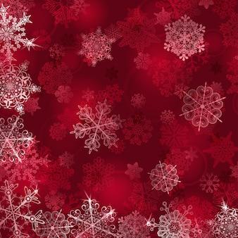 Kerstachtergrond met sneeuwvlokken in rode kleuren
