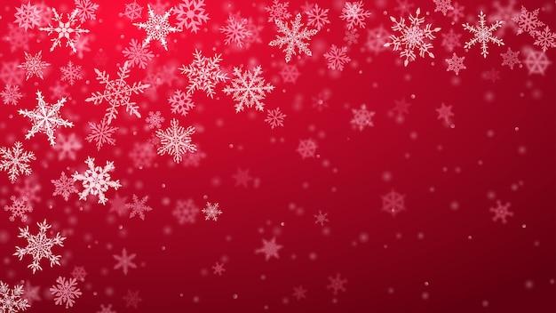 Kerstachtergrond van complexe wazige en heldere vallende sneeuwvlokken in rode kleuren met bokeh-effect