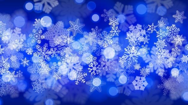Kerstachtergrond van grote en kleine sneeuwvlokken met bokeh-effect, in blauwe kleuren