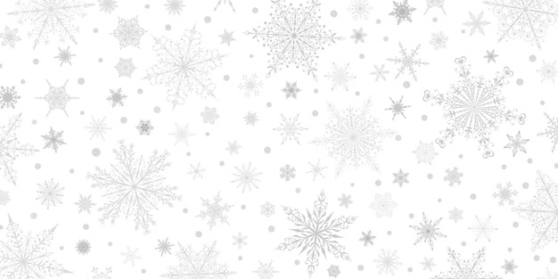 Kerstachtergrond van verschillende complexe grote en kleine sneeuwvlokken, grijs op wit