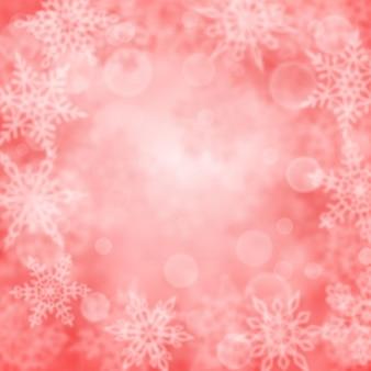 Kerstachtergrond van wazige sneeuwvlokken in roze kleuren