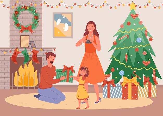 Kerstavond thuis, vader geeft dochter een cadeautje, thuisblijven, nieuwjaar en wintervakantie.