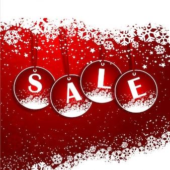 Kerstballen met verkoop writted op een rode achtergrond