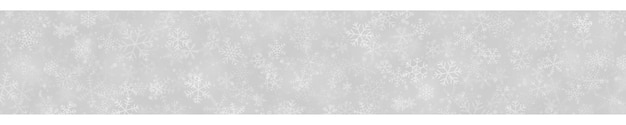 Kerstbanner van sneeuwvlokken in verschillende vormen, maten en transparantie op grijze achtergrond