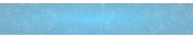 Kerstbanner van sneeuwvlokken in verschillende vormen, maten en transparantie op lichtblauwe achtergrond