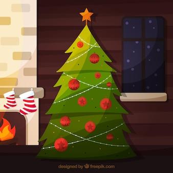 Kerstboom bij de open haard