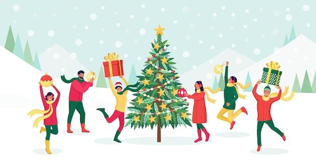 Kerstboom met decoratieballen, slinger, kerstballen. vrienden die kerstmis vieren. mensen wensen prettige kerstdagen en gelukkig nieuwjaar. vakantie groet. vrolijke mensen springen met geschenkdozen