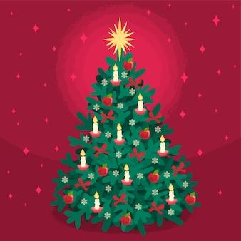 Kerstboom versierd met kaarsen en appels