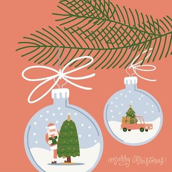 Kerstboomversieringen hangende ballen met sneeuwlandschap in dennentak met kerstballen die...