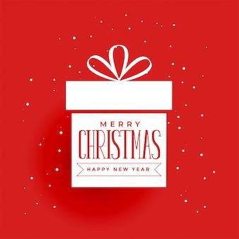 Kerstcadeau op rode achtergrond