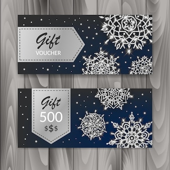 Kerstcadeaubon kaartenset. sjabloon met glanzende sneeuwvlokken. vector illustratie