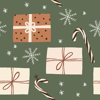 Kerstcollectie met geschenkdoos in traditionele snoepsneeuwvlokken in inpakpapier