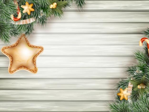 Kerstdecoratie met fir takken op witte houten bord.