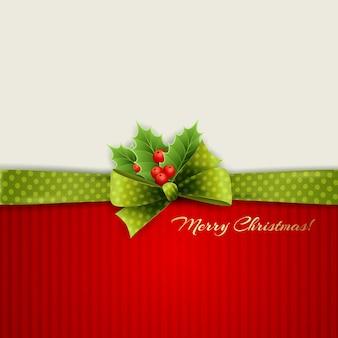Kerstdecoratie met hulst bladeren en groene polka dot boog