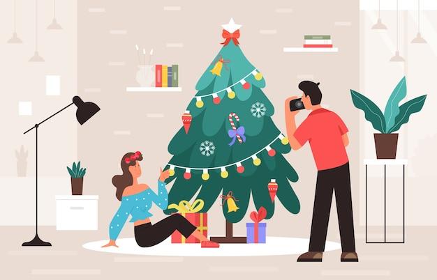 Kerstfotosessie in de buurt van dennenboom in huis of studio-interieur Premium Vector