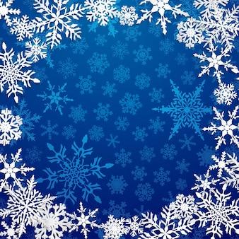 Kerstillustratie met cirkelframe van grote witte sneeuwvlokken met schaduwen op blauwe achtergrond