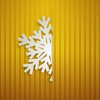 Kerstillustratie met een witte grote sneeuwvlok die uit de snede steekt op een gestreepte achtergrond in gele kleuren